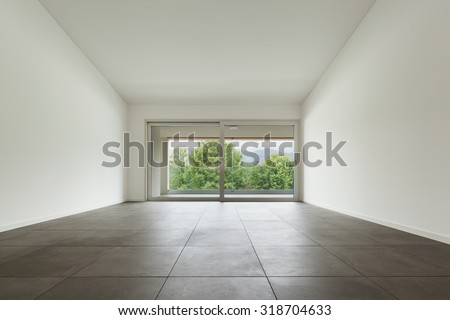 interior of new apartment, wide room with window, tiled  floor - stock photo