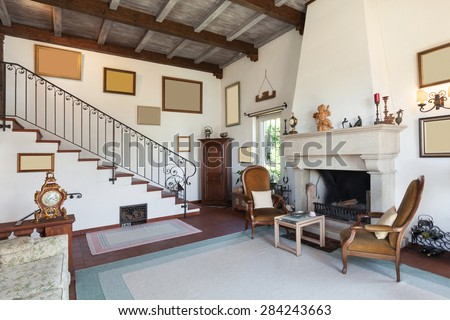 interior of old house, classic furniture, living room with fireplace  - stock photo