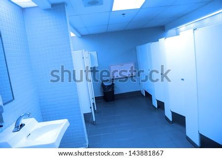 Interior of public washroom with blue toned - stock photo