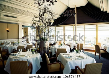interior of restaurant with big window - stock photo