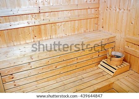 Interior of small Finnish wooden sauna - stock photo