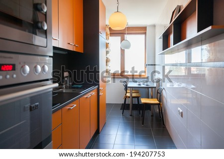 interior of small white kitchen with coffee on the table - stock photo