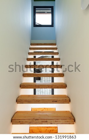 Interior of stylish modern house, view of the stairs - stock photo