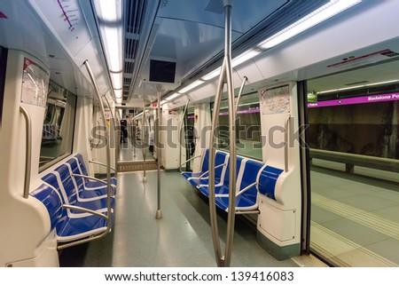 Interior of  subway train in spanish metro - stock photo