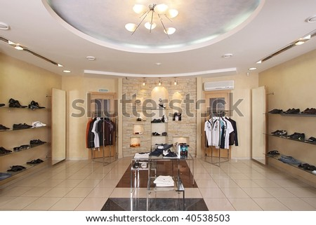 Interior of the big shop of fashionable clothes - stock photo