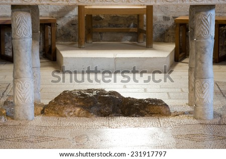 Interior of the Church of the Multiplication of the Loaves and Fish with the rock under the altar where Jesus placed the fish and bread - stock photo