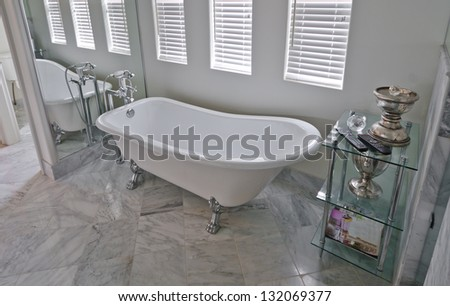 Interior of the luxury modern house bathroom with marble floor. - stock photo