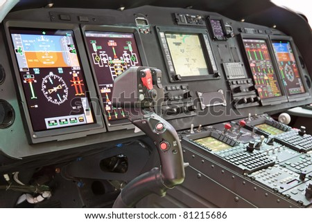 Interior of the modern helicopter and handle control - stock photo