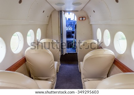 Interior of the small retro passenger airplane. - stock photo