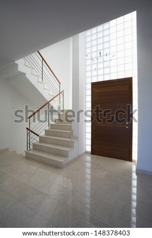 Interior of town house with staircase and door - stock photo