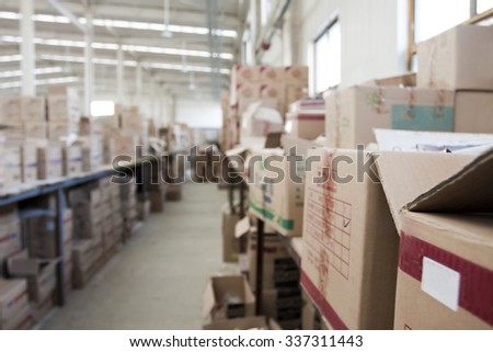 interior of warehouse. Rows of shelves with boxes - stock photo