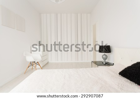 Interior of white contemporary bedroom with black details - stock photo