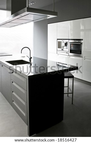 Interior of white kitchen with big counter - stock photo