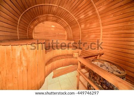 Interior of wooden sauna cabin - stock photo
