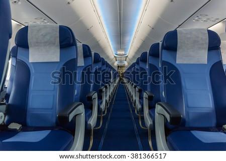 Interior passenger airliner cabin - stock photo