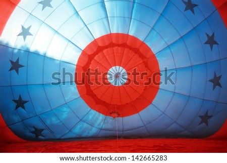Interior red and blue hot air balloon while inflating. - stock photo