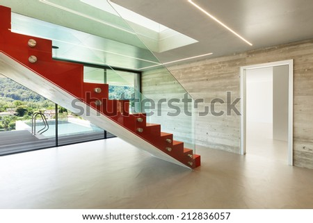 Interior, red staircase in modern villa - stock photo