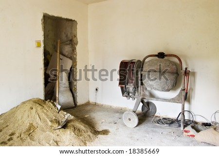 interior renovations with sand and concrete mixer machine - stock photo