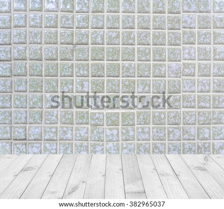 Interior room with old square tiles ceramic deep green color with grey filling wall and wooden floor - stock photo