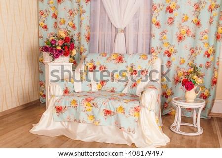 Interior rooms are decorated with artificial flowers in a vase and a basket - stock photo