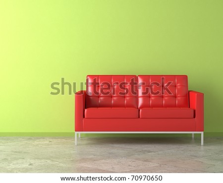 interior scene of vivid red couch on green vibrant wall - stock photo