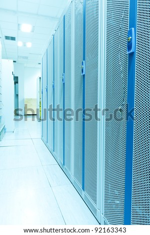 Interior shot of a large, partially empty computer datacenter. - stock photo