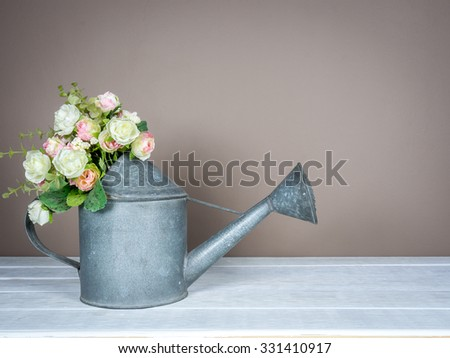 Interior still-life, artificial flower in aluminum can on wooden table/ home improvement concept - stock photo
