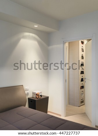 interior view of a modern bedroom overlooking on the wardrobe - stock photo