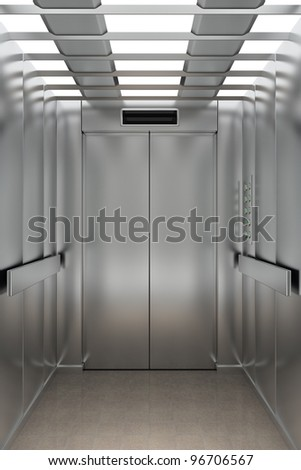 Interior view of a modern elevator facing the entrance doors - stock photo