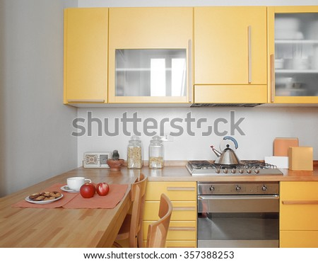 interior view of a modern kitchen in foreground the cooker - stock photo