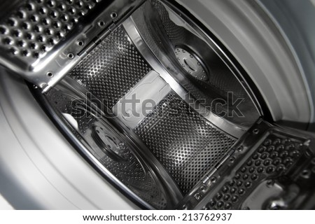 Interior view of a new european top loading washing machine. - stock photo