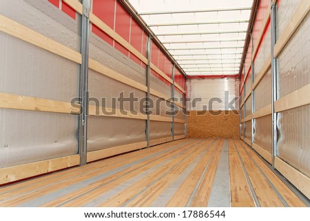 Interior view of empty semi truck trailer - stock photo