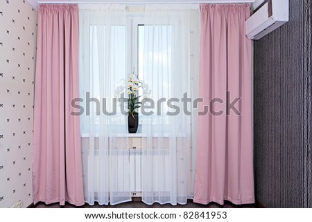 Interior view of window with curtains in bedroom - stock photo