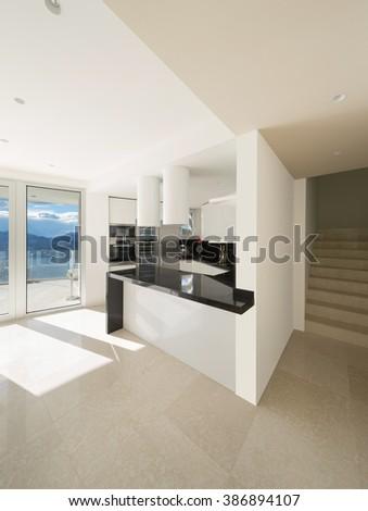 Interior, wide open space with kitchen modern design - stock photo