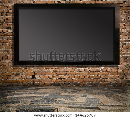 interior with a television set on an old wall - stock photo