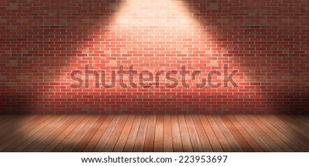 Interior with brick wall and wooden floor illuminated by bulb. - stock photo