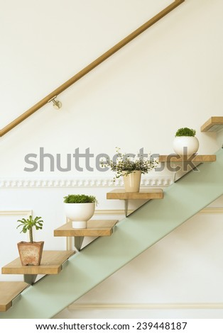 interior with curtains, stairs and flower - stock photo