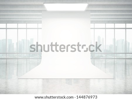 interior with large windows and white backdrop - stock photo