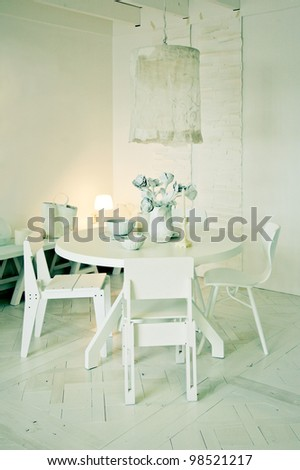 interior with stylish white dinner table - stock photo