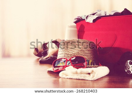 interior with window and open suitcase  - stock photo