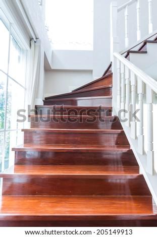 Interior wood stairs and handrail - stock photo
