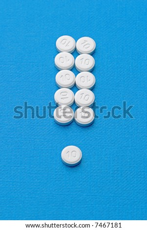 interjection made of pills on blue - stock photo