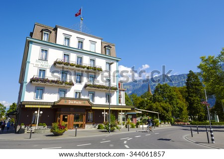 INTERLAKEN, SWITZERLAND - SEPTEMBER 07, 2015: The four-star historic Hotel Du Nord was built in 1847. The property is located in the center of city and offers 58 guest rooms - stock photo