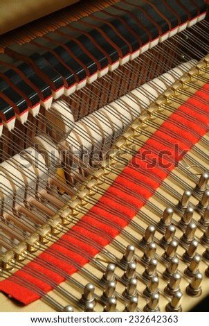 Internal of a grand piano - strings and hammers - stock photo