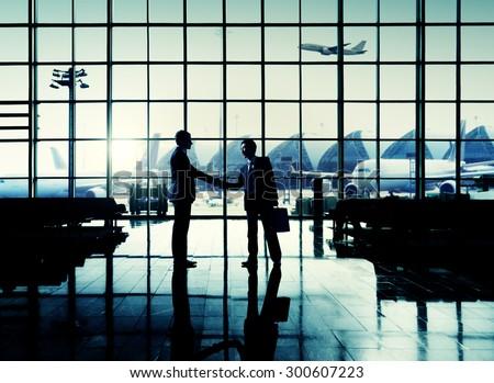 International Airport Business Travel Airport Handshake Concept - stock photo