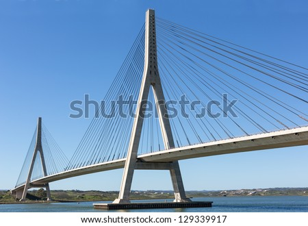 International Bridge, linking Portugal and Spain over the Guadiana river. - stock photo