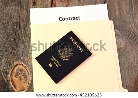 International business contract on rustic wood table - stock photo