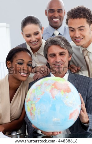 International business group smiling at global business expansion in the office - stock photo