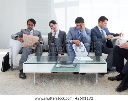 International business people sitting in a waiting room. Business concept. - stock photo