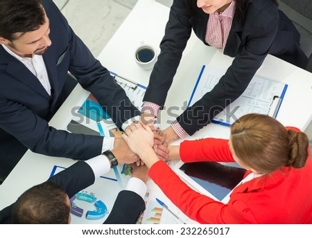 International business team are showing unity with their hands together. - stock photo